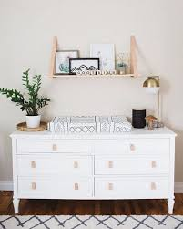 a stylish ikea tarva dresser with elegant legs and leather pulls into a boho changing