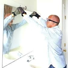 wall mirror adhesive remove mirrors glued from tilt the away decorative front gates self art w wall mirror adhesive