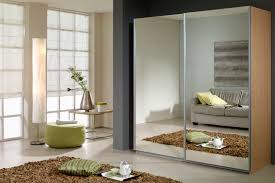 Interior:Futuristic Sliding Mirrored Closet Door Decoration With White  Curtain And Brown Fur Rug Idea