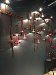 into lighting. Exposed Pipes Turned Into Lighting Fixtures