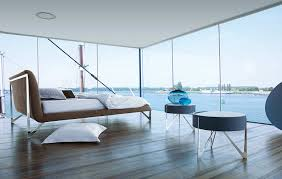 Bedroom with a glass wall and ocean view