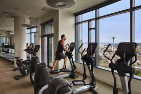 michael blume enjoys a spectacular view as he works out in cirrus gym blume