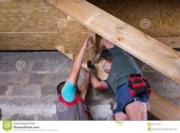 Two Men Building Stairs In Unfinished Basement Stock Photo Image - Unfinished basement stairs