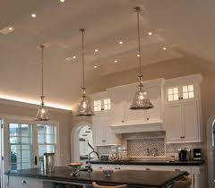 hanging multiple pendants over your kitchen island adds visual interest and serves a practical purpose it spreads out the light to cover the whole surface
