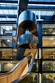google office in uk. googlers enjoying the stairs and view from a half-landing - google offices, office in uk o