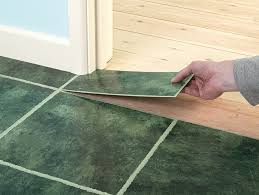 materials and tools needed for installing vinyl floor tiles