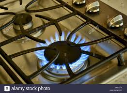 gas stove top. Perfect Stove A Gas Stove Top Turned On With Flames Present Inside Gas Stove Top