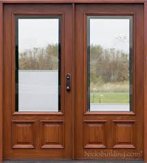 exterior mahogany door with shades between glass