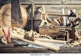 ancient wooden tools. antique carpentry workshop with tools on old wooden table - stock image ancient o