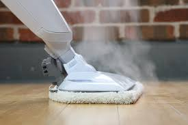 steam ing out of a mop on hardwood floors