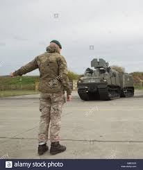 Marine Corps Hand Signals A British Royal Marine Helps Position The Bvs 10 By
