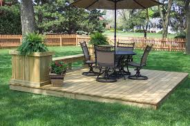 increase the value of your outdoor space by ground level deck carehomedecor