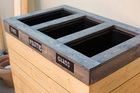 find the free plans for this double bin diy recycling center at ana white one of her readers actually did this particular project so you know you can do
