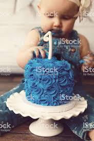 Baby Girl Eating Her First Birthday Cake Stock Photo More Pictures