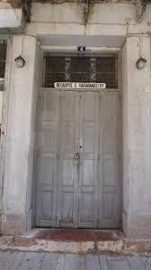 old wooden door in nafplio a seaport town in the peloponnese in baby wooden expanding