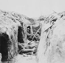 archived trench warfare oral histories of the first world war photograph of two canadians resting in their funk holes on the front line 1917