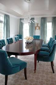 loooove the pale blue walls the lacquered shimmery ceiling and the shades of teal chairpea dining roomturquoise