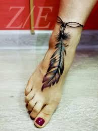 татуировка на ступне у девушки перо фото рисунки эскизы