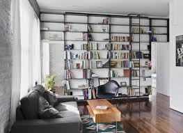 image ladder bookshelf design simple furniture. Custom Made Minimal, Blackened-Steel Bookshelves With Rolling Library Ladder Image Bookshelf Design Simple Furniture R
