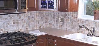 Mosaic backsplash made of small square tiles