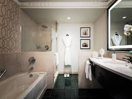 glass encased rain showers spacious tubs and luxe lanvin s make the bathrooms at the sofitel washington dc lafayette square the ideal tranquil