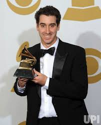Adam Machado Holds Grammy for Best Album Notes at the 54th annual Grammy  Awards at the Staples Center in Los Angeles - UPI.com