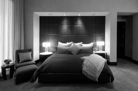 bed sheet designing black wall panel combined with black bed sheet with pillow between