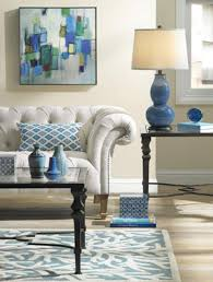 a living room setting with a blue gourd table lamp