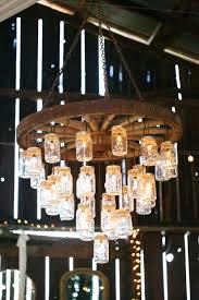 diy wagon wheel chandelier mason jar wagon wheel wedding chandelier for rustic barn weddings metal wagon