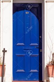 House Number 53 On A Royal Blue Wooden Front Door With Vertical.. Stock  Photo, Picture And Royalty Free Image. Image 147459162.