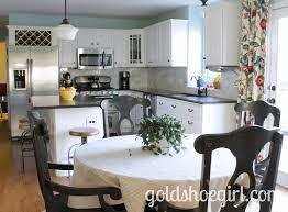 creative white kitchen cabinets black granite blue walls
