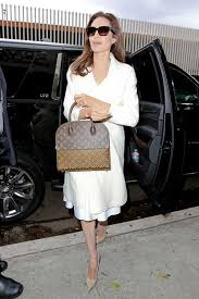louis vuitton tote celebrity. angelina jolie steps out with $5,150 louis vuitton x christian louboutin shopping tote celebrity