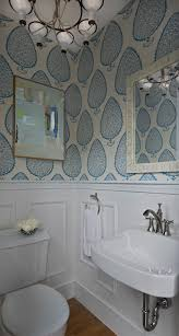 Elegant ... Chandelier From Schoolhouse Electric Illuminating A Blue Abstract  Painting Atop Upper Walls Clad In Katie Ridder Leaf Wallpaper Over Lower  Walls Paneled ...