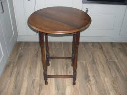 a vintage oak round table with attractive turned legs