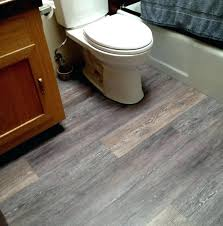 cutting vinyl plank flooring how to cut around toilet interesting bathroom with white