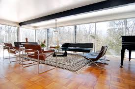 Inspiration for a modern medium tone wood floor living room remodel in  Other with a music