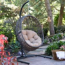 com resin wicker espresso hanging egg chair with tufted khaki cushion and stand garden outdoor