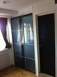 decoration excellent black glass panel pax sliding doors for your