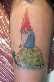while this gnome tattoo shows a gnome with a pointy red hat and a blue jacket