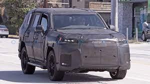 2022 Lexus LX 600 Spied In Heavy Camo Hiding Land Cruiser Bones