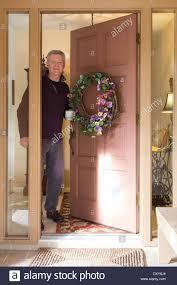 opening front door. Striking Opening Front Door Mature Man Of Residential Home, FL,USA Stock I