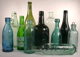 grouping of soda mineral water bottles to enlarge
