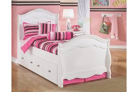 girls bed furniture. twin trundle bed pulled out and shown with pink bedding girls furniture ashley homestore