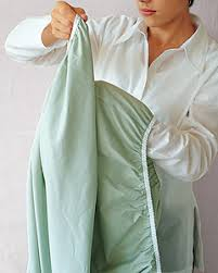 fold fitted sheet fold a fitted sheet in 5 steps martha stewart