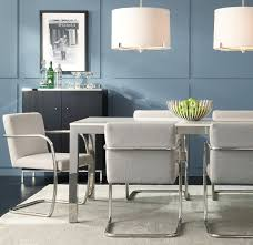 sleek silver chairs with dining set love this white quartz and stainless steel parsons table from mitc gold bob williams awesome loveit mgbw