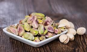 nutritional value of pistachios sandi busch pistachios in a bowl on wood