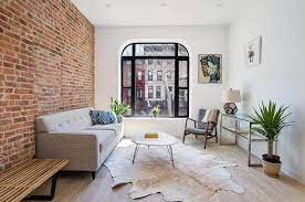 exposed brick wall living room design