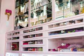 pink walk in closet with clear drawer fronts