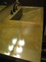 concrete vanity with integral ramp sink acid stained with clear coat