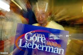 Ida Cohen holds a Gore-Lieberman poster during a speech by the... News  Photo - Getty Images